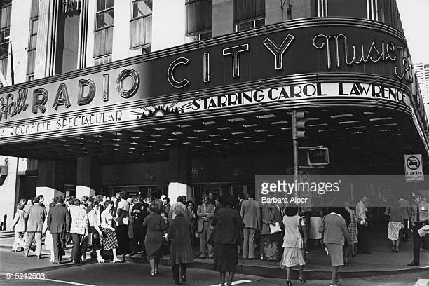 A crowd outside Radio City Music Hall on the Avenue of the Americas Manhattan New York City 6th December 1980