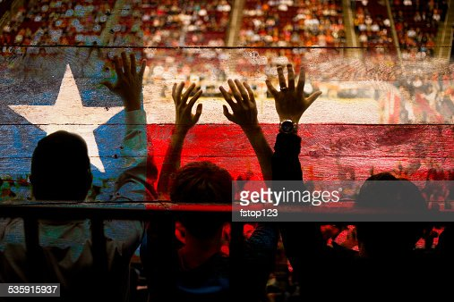 Crowd people at sports stadium. Texas flag. Basketball court. Fans. : Stock Photo