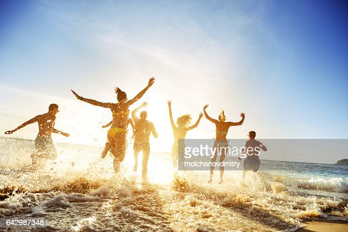 Crowd people friends sunset beach holidays : Stock Photo