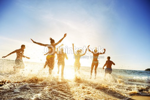 Crowd people friends sunset beach holidays : Stock Photo