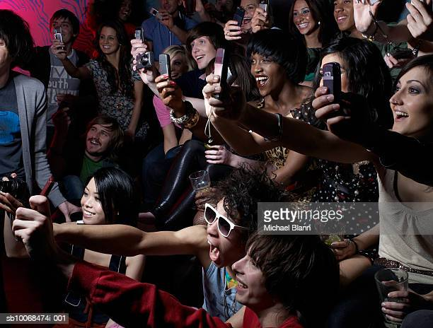 Crowd photographing using mobile phones at party