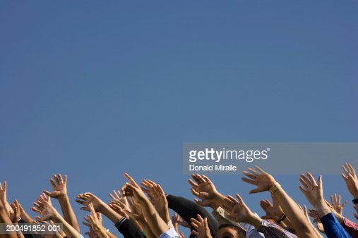 Crowd raising hands in air : Stock Photo