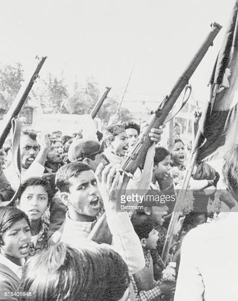 Crowd Reacts to News Dacca Bangladesh Crowd raised guns in the air January 4 after news of the impending release of Awami League Party leader Sheikh...
