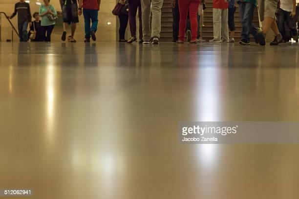 Crowd reflecting on floor