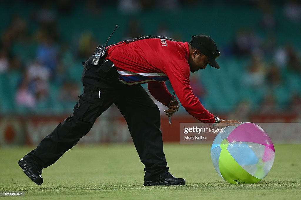 A crowd safety worker collects a beachball from the field during game four of the Commonwealth Bank One Day International Series between Australia and the West Indies at Sydney Cricket Ground on February 8, 2013 in Sydney, Australia.