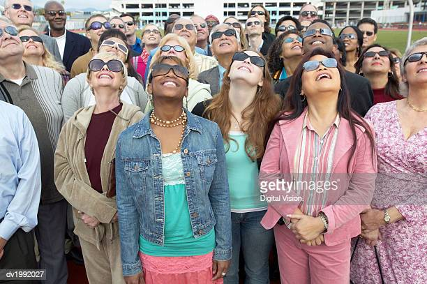 Crowd Standing Wearing Sunglasses Looking Up