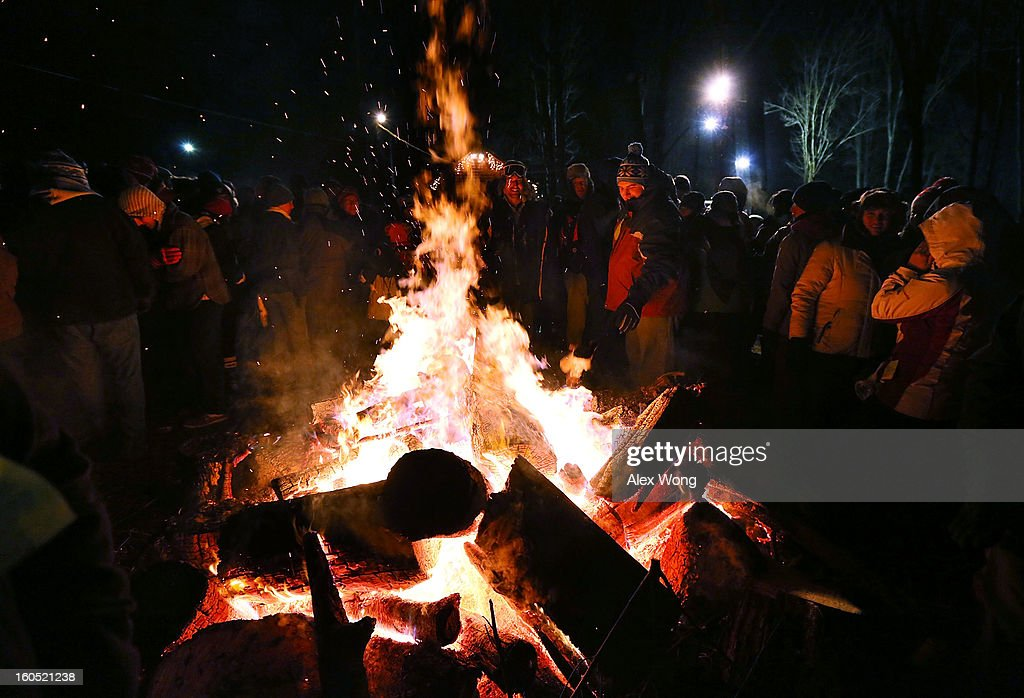 A crowd surround a fire to keep themselves warm during the 127th Groundhog Day Celebration at Gobbler's Knob on February 2, 2013 in Punxsutawney, Pennsylvania. Thousands of people gathered at the event to watch Phil's annual forecast.