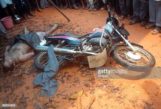 A crowd surrounds the body of Indian Christian priest James Mukalel at Thottathady some 30kms east of Mangalore on July 30 2009 Police in southern...