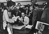 Crowd throngs around Alex Haley author of book Roots at the Broadway department store book department in Fox Hills Mall Those waiting to have Haley...