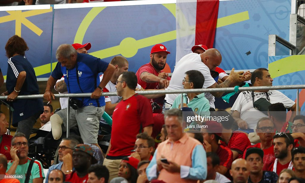 Crowd trouble is seen in the stand during the UEFA EURO 2016 quarter final match between Poland and Portugal at Stade Velodrome on June 30, 2016 in Marseille, France.