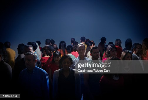 Crowd turning back on bright light