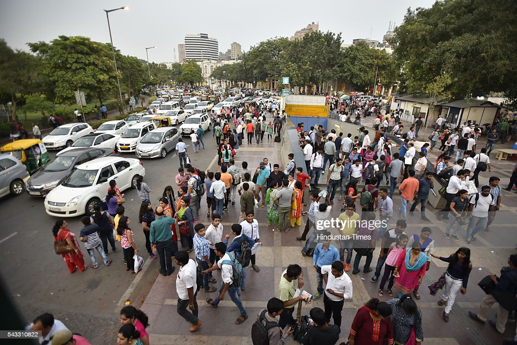 Crowd wait outside as Policemen stopped people from entering the Rajiv Chowk metro station to prevent overcrowding as the as metro services halts due to a technical glitch on June 27, 2016 in New Delhi, India. Due to the breakdown of an overhead wire between Subhash Nagar and Tilak Nagar Metro stations, operations on the entire 51-km-long route remained affected for two-and-half hours.