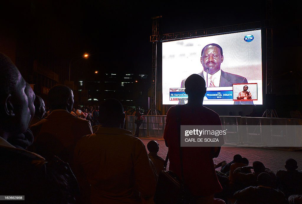 A crowd watches Presidential candidate Raila Odinga during the second and last televised debate for the 2013 Kenya elections on a large screen in Central Nairobi on February 25, 2013. Kenyans will vote for a new leader on March 4, 2013. AFP PHOTO/Carl de Souza