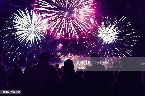 Crowd watching fireworks and celebrating new year eve : Stock Photo