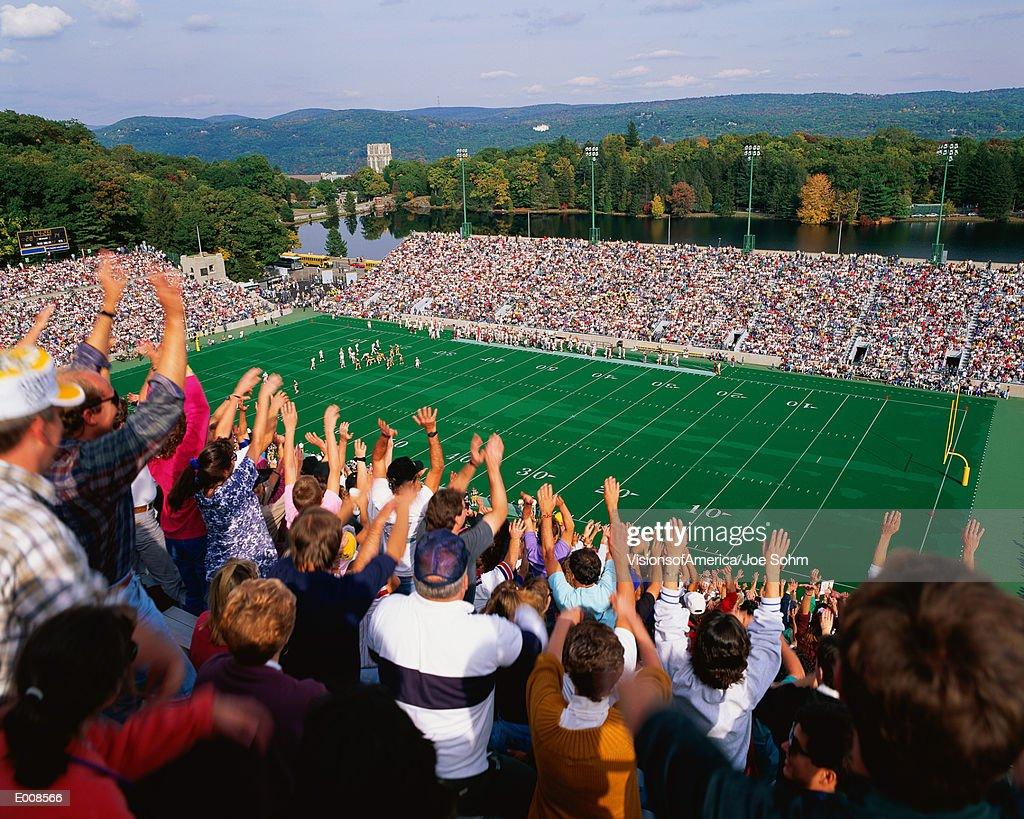 Crowd watching football game : Stock Photo