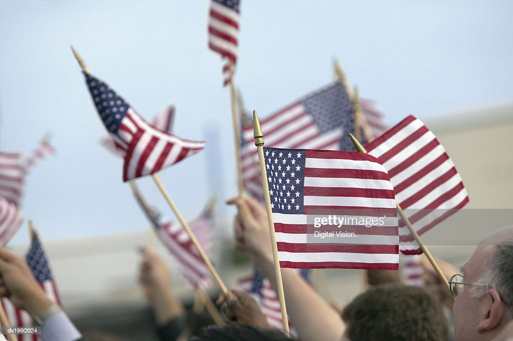 Crowd Waving Stars and Stripes Flags : Stock Photo