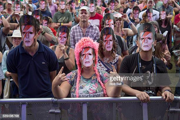 Crowd wearing David Bowie masks to help raise awaeness for the charity Stand up to Cancer at the Isle Of Wight Festival 2016 at Seaclose Park on June...
