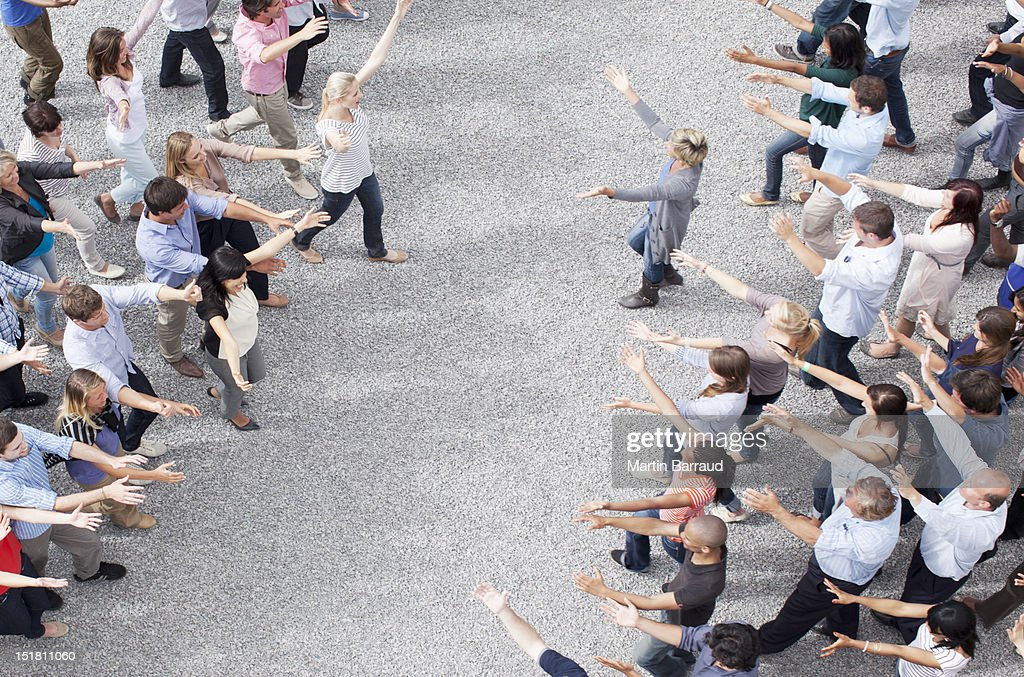 Crowd with arms outstretched : Stock Photo