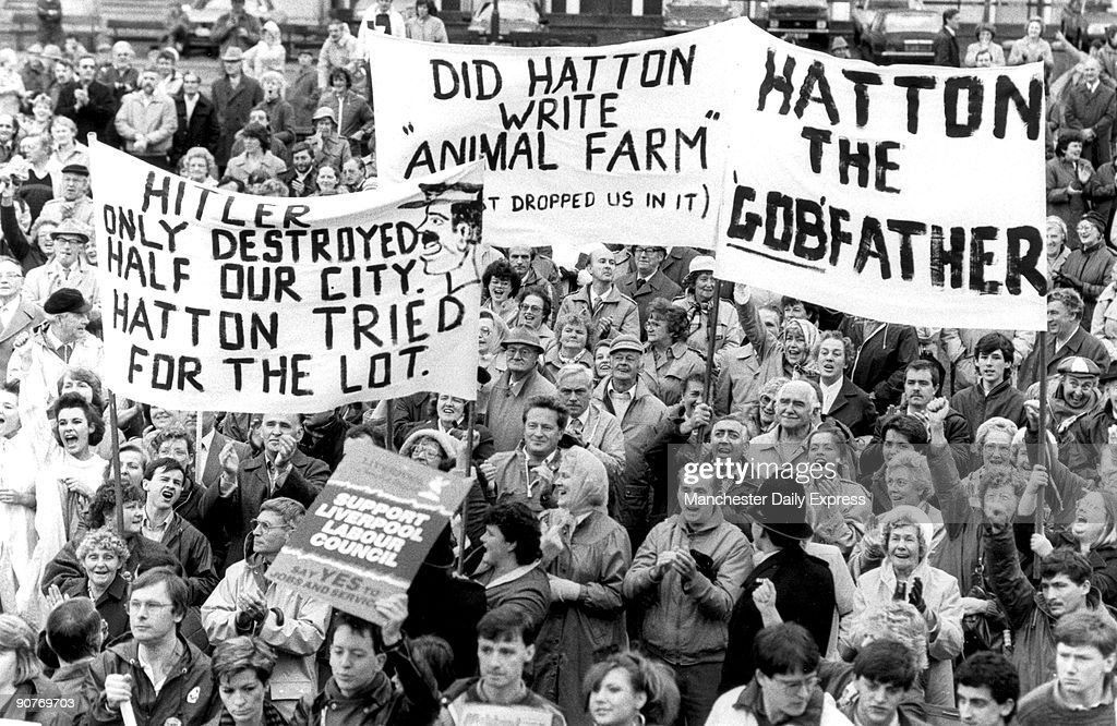 Crowd with banners protesting about Derek Hatton, deputy leader of Liverpool Council. One of the banners reads: �Hitler only destroyed half our city. Hatton tried for the lot�. Hatton was thrown out of the Labour Party that year for belonging to the left-wing Militant Tendency. Militant was a faction inside the Labour Party that advocated Trotskyist policies.