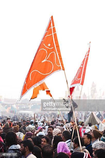 Crowd with flags at the royal bath procession at Maha Kumbh Allahabad Uttar Pradesh India