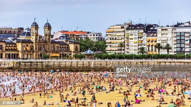 Crowded Beach In Summer. San Sebastian Donostia, Spain.