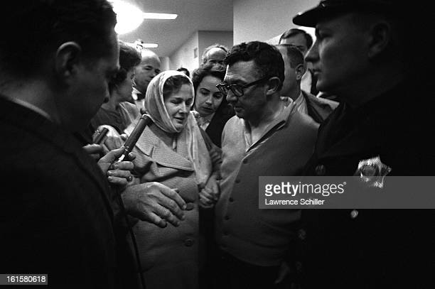 Crowded by police and members of the press Eva Grant and Earl Ruby sister and bother of Jack Ruby walk down the hall on the second floor of the...