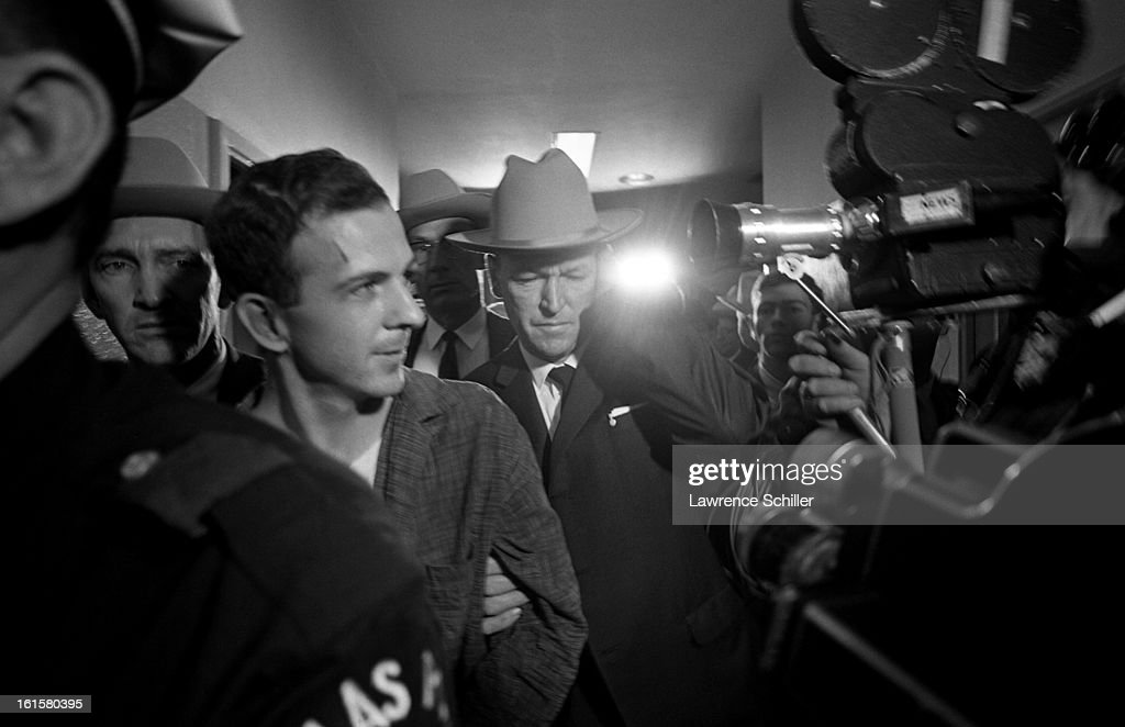 Crowded by police and members of the press, the accused assassin of President John F. Kennedy, <a gi-track='captionPersonalityLinkClicked' href=/galleries/search?phrase=Lee+Harvey+Oswald&family=editorial&specificpeople=93679 ng-click='$event.stopPropagation()'>Lee Harvey Oswald</a> (1939 - 1963) (second left), is taken down the hall on the second floor of the Dallas Police Department building, Dallas, Texas, November 22, 1963. He was shot, in the same police station, two days later by Jack Ruby.