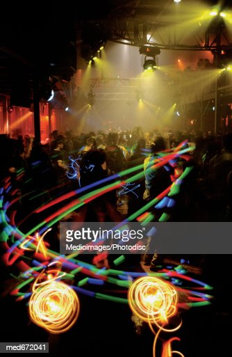 Crowded dance floor in club with strobe lights : Stock Photo