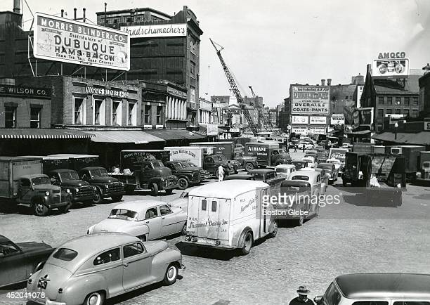 A crowded market district While most of the advertising was for businesses long gone from the Boston scene a Union Oyster House truck can be seen in...