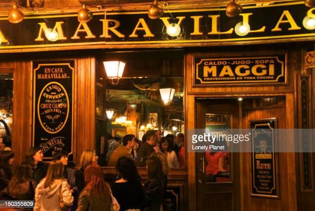 Crowded night-time bar in Malasana.