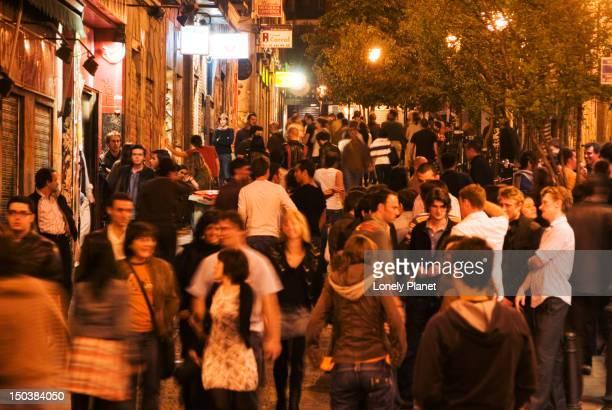 Crowded night-time street in Malasana.