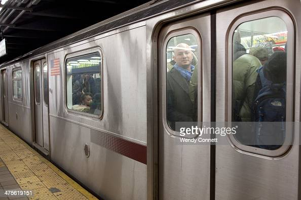 A crowded number 6 Lexington Avenue line subway train pulls out of the 51st Street Lexington Avenue station in Midtown Manhattan New York City United...