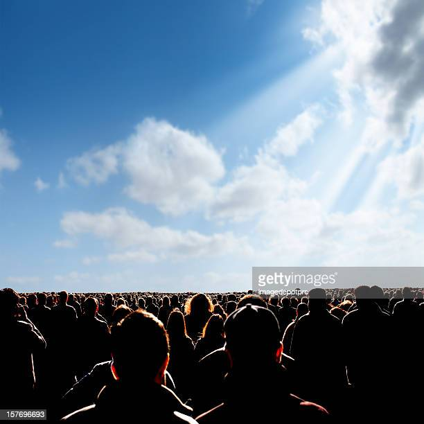 crowded people over sunny sky