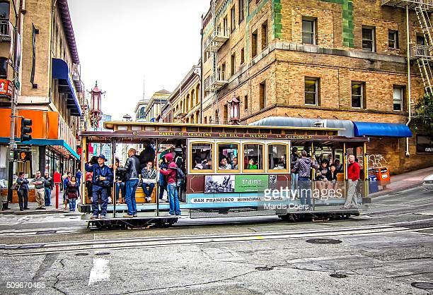 A crowded San Francisco Cable Car passes through Chinatown