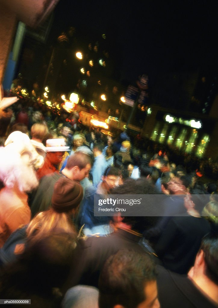 Crowded street at night, blurred : Stock Photo