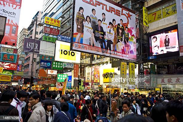 Crowded street in shopping area.