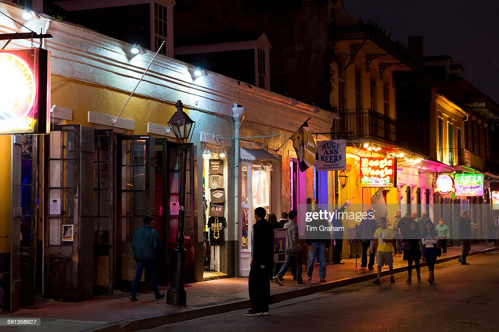 Crowded street scene and Boogie Woogie jazz music club in famous Bourbon Street in French Quarter of New Orleans USA
