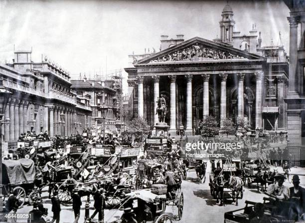 Crowded street scene in front of the Royal Exchange London c1900 Horse drawn vehicles including omnibuses with advertisements fill the street in...
