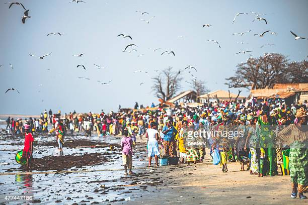 Crowded West African fish market at the beach.