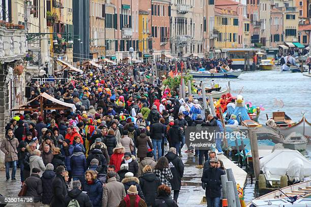 Crowds along the sides of rio Canareggio to watch the regatta that officially opens the Venice Carnival