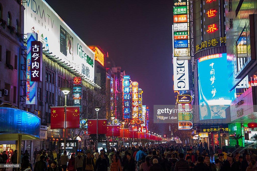 Crowds and neon signs at Nanjing Road