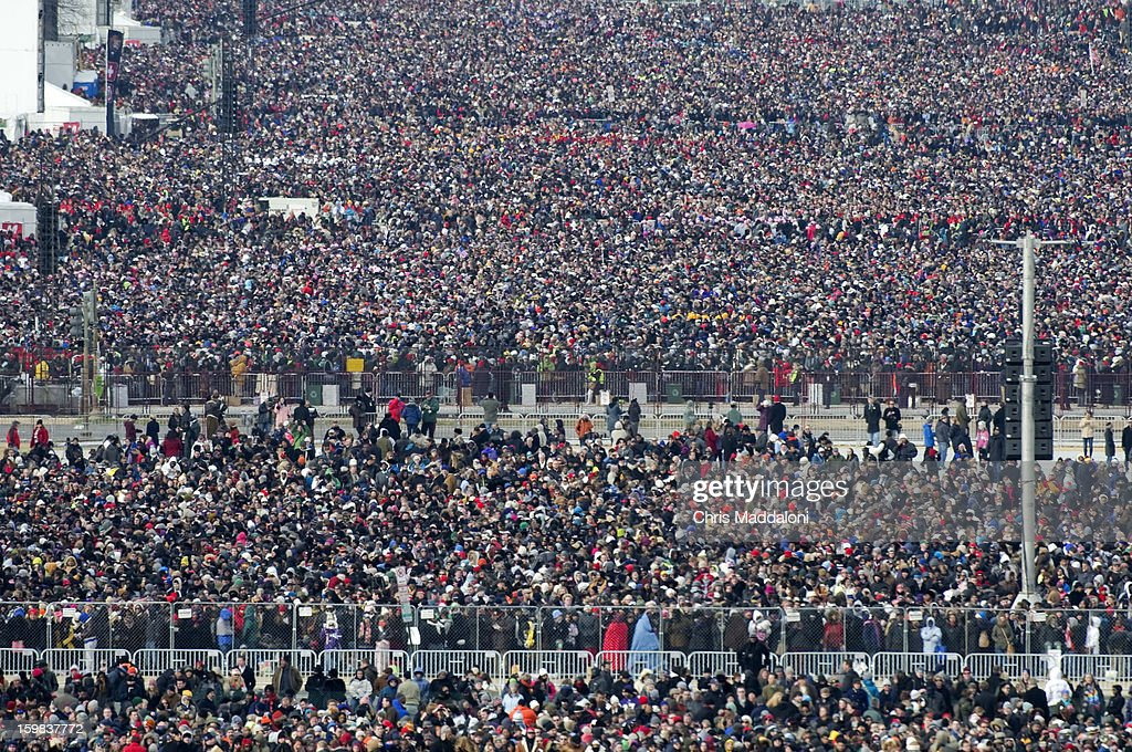 Crowds arrive on the Mall to see U.S. President Barack Obama sworn-in at the inauguration for his second term of office. More than 600,000 people attended the event.