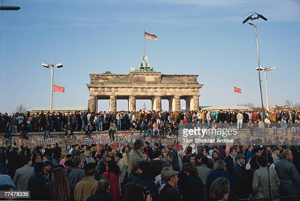 Crowds at the Brandenburg Gate bear witness to the Fall of the Berlin Wall 10th November 1989