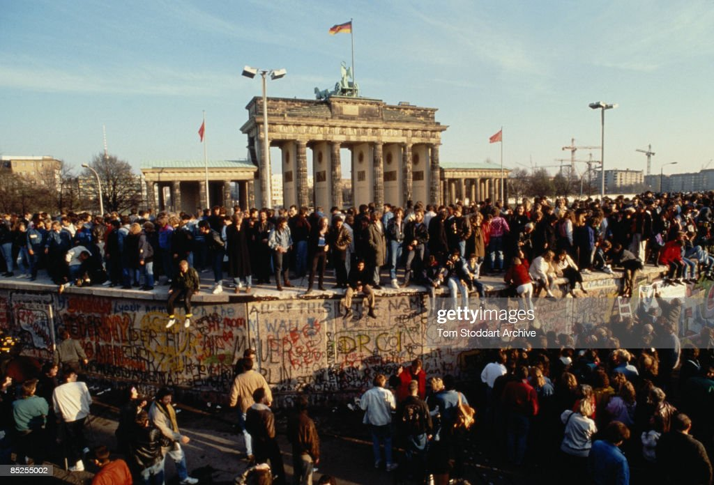 Crowds at the Brandenburg Gate bear witness to the Fall of the Berlin Wall, 10th November 1989.