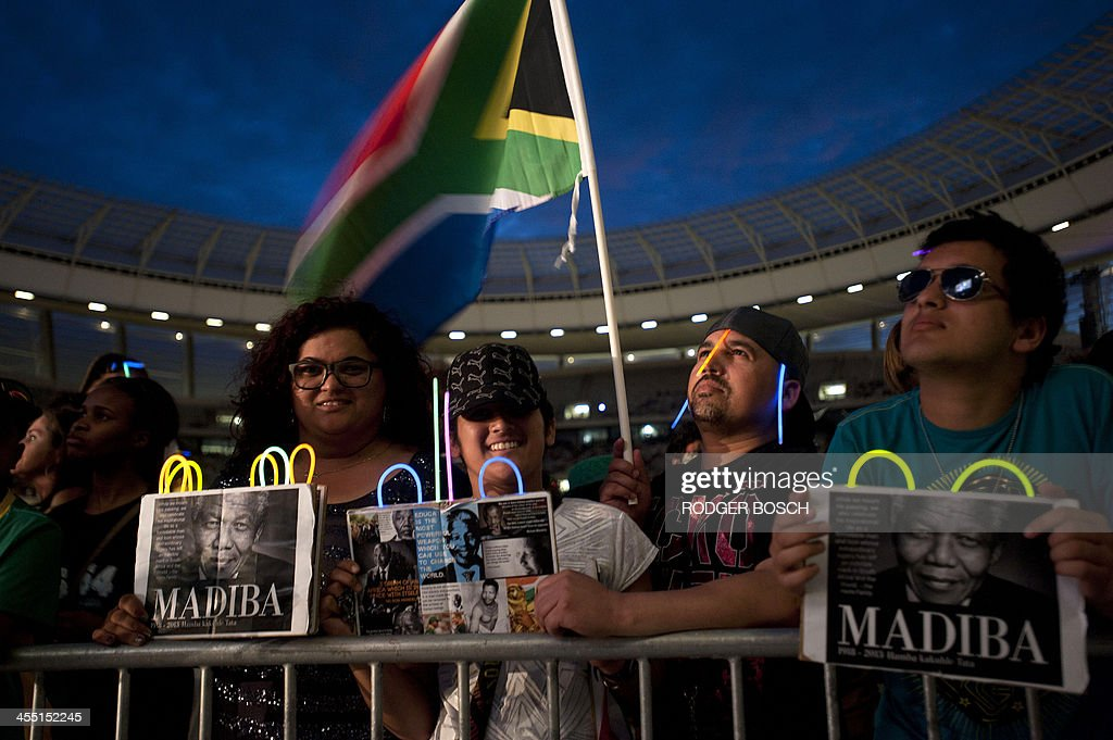 Crowds attend the Nelson Mandela tribute concert called 'A Life Celebrated' at Cape Town Stadium on December 11 2013 Mandela the revered icon of the...