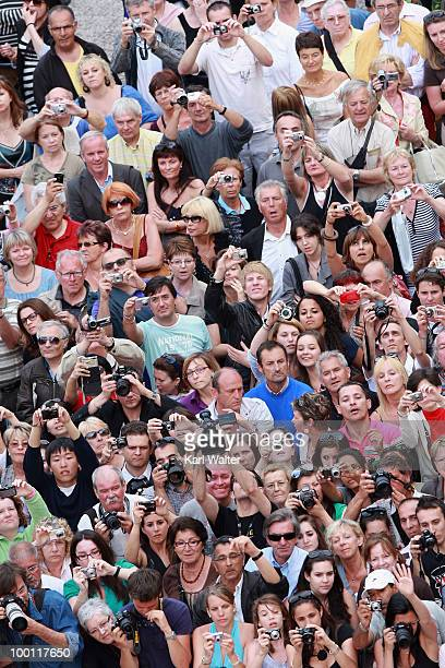 Crowds attend the 'Outside Of The Law' Premiere at the Palais des Festivals during the 63rd Annual Cannes Film Festival on May 21 2010 in Cannes...