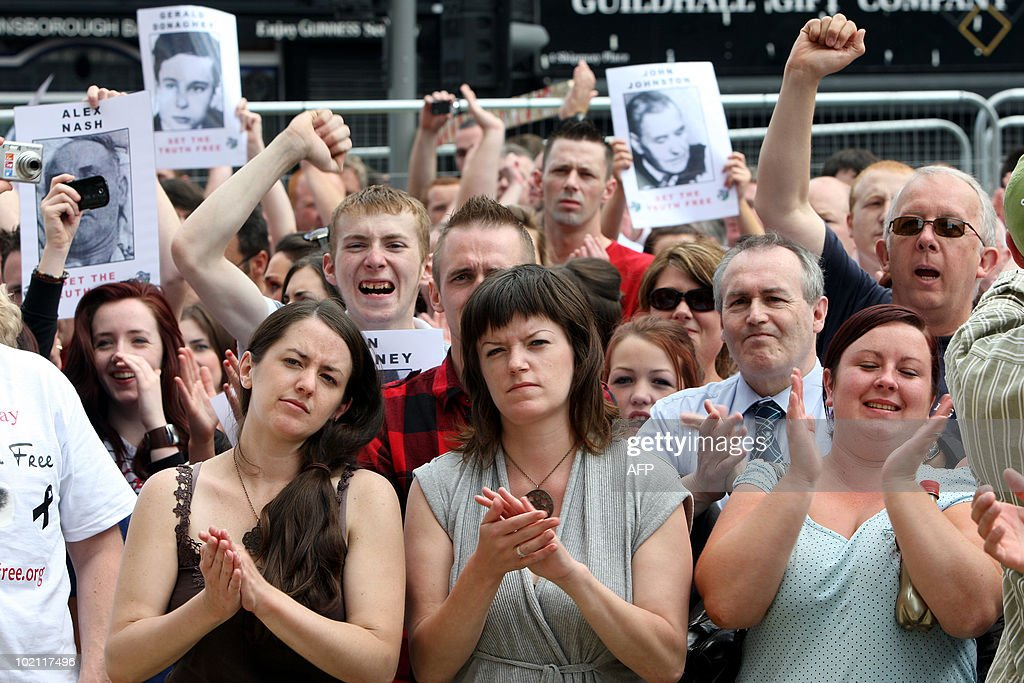 Crowds celebrate the findings of the long-awaited Saville Inquiry report into Bloody Sunday, after relatives of the victims read the first copies, outside the Guildhall in Londonderry on June 15, 2010. Publication of the report was greeted with cheers in Londonderry, Northern Ireland's second city, where relatives of those who died joined thousands waiting to see the contents of the 5,000-page report. The killings, when British soldiers opened fire on a civil rights march in Londonderry, was one of the most controversial in Northern Ireland's history, and there had been fears the report could re-open wounds.