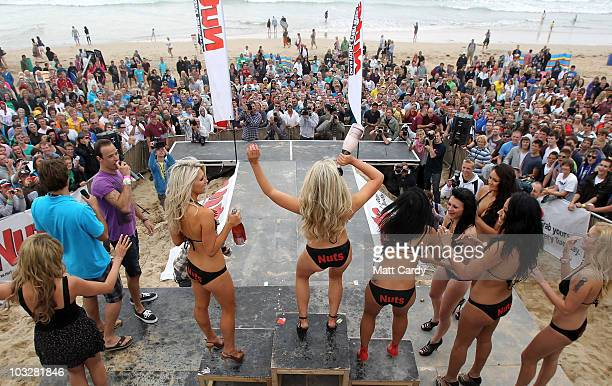 Crowds cheer as Brandy Brewer celebrates winning the 2010 Nuts Magazine Bikini Babe competition at the Relentless Boardmasters on Fistral beach dance...
