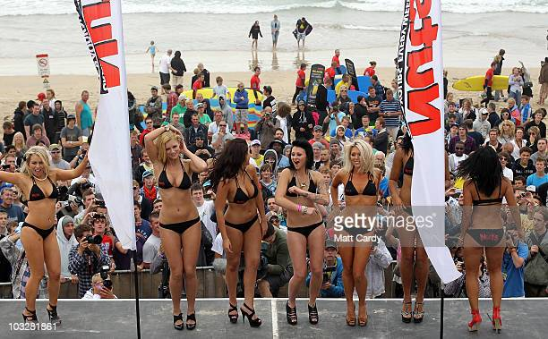 Crowds cheer as contestants in the 2010 Nuts Magazine Bikini Babe competition at the Relentless Boardmasters on Fistral beach dance on stage on...