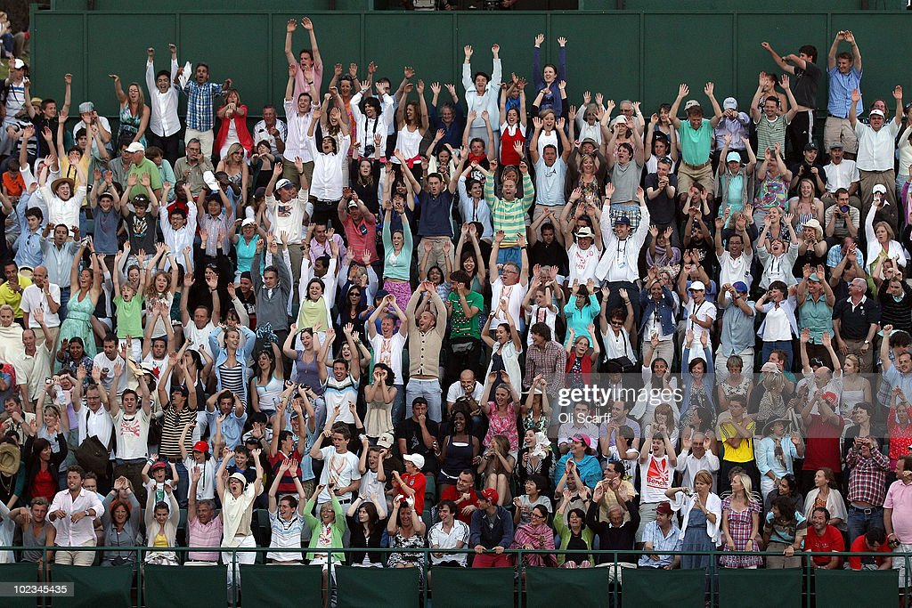 Crowds cheer as Nicolas Mahut and John Isner's match is stalled at 59 - 59 in the last set on Day Three of the Wimbledon Lawn Tennis Championships at the All England Lawn Tennis and Croquet Club on June 23, 2010 in London, England. The match has become the longest in Grand Slam history.